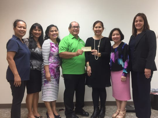 "The University of Santo Tomas Alumni Organization of Guam donated $500 to the Guam Diabetes Association for its 18th Annual Conference held Nov. 12 at the Guam Hilton Resort & Spa. The conference theme is ""How Diabetes Affects the Heart"". Pictured: Glynis Almonte, GDA Secretary/USTAOG Director, Clara Peterson, GDA Vice President, Jovette Alcantara, USTAOG Treasurer, Scott Duenas, GDA President, Gemma Conlu, USTAOG President, Aurora Cabanero, USTAOG Director, and Alma Domingo, USTAOG Director."
