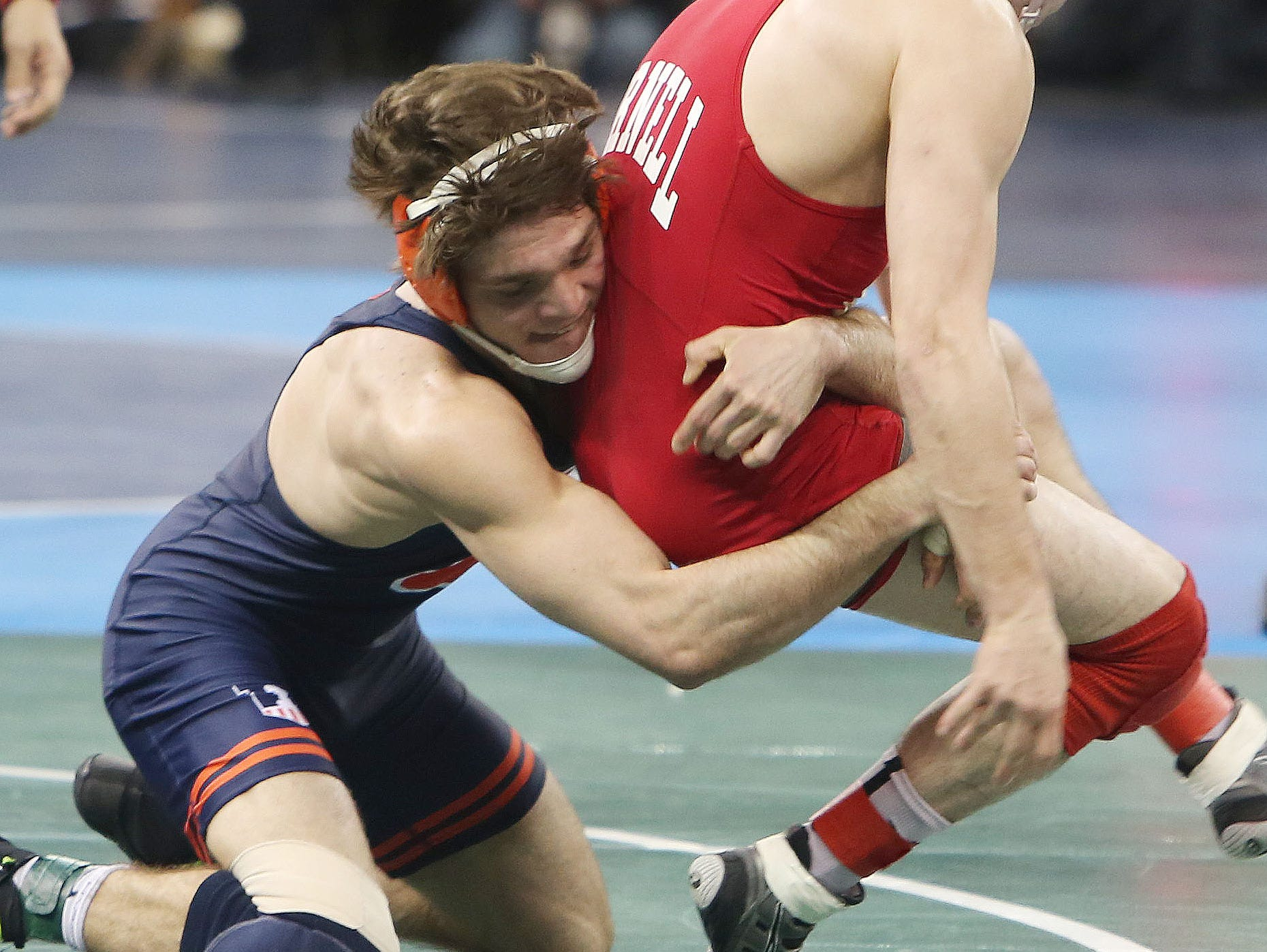 From left , Illinois' Steven Rodrigues on his way to defeating Cornell's George Pickett in the quarterfinals of the 165-pound weight class during the NCAA Wrestling Championships at Madison Square Garden March 17, 2016. Rodrigues, a Fox Lane graduate, won the match.