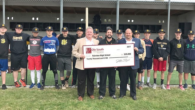Ole South Properties presents a check to Fairview High Baseball Program - Front row (l-r) Trey Lewis with Ole South, Head Baseball Coach Matt Putnam, Todd Ryan with Ole South; Back row – members of the Fairview High School Yellow Jacket Baseball Team.