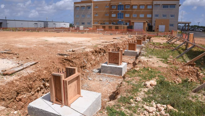 Wooden forms, for the foundation of a warehouse being built, are seen near the newly constructed Guam Department of Education building in Tiyan on Thursday, May 18, 2017.