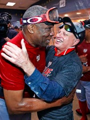 FILE - In this Sept. 24, 2016, file photo, Washington Nationals manager Dusty Baker, left, gets a hug from Nationals principal owner Mark D. Lerner while celebrating in the locker room after clinching the National League East following a 6-1 win over the Pittsburgh Pirates in a baseball game in Pittsburgh. Now that the Cubs have broken baseball's oldest curse, who's next? Washington hasn't celebrated forever.