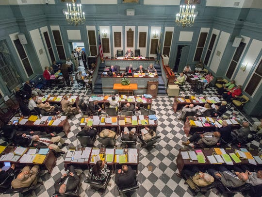 Lawmakers attend a session in the Delaware Statehouse