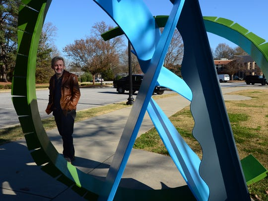 """Artist Joey Manson explains the meaning behind his sculpture called """"The Depot"""" following a dedication ceremony on Mauldin Public Art Trail behind the Mauldin Cultural Center on Tuesday."""