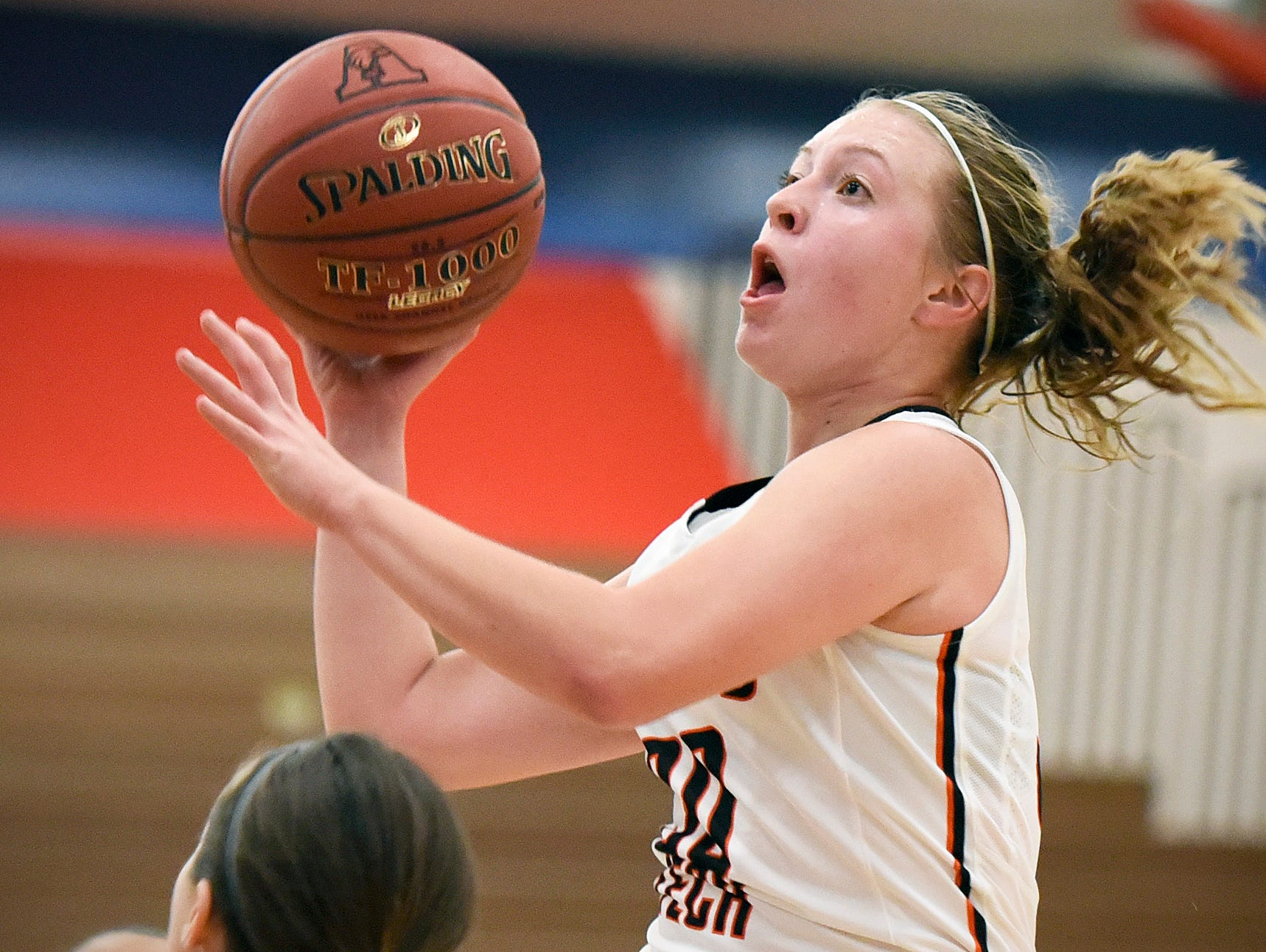 Tech's Abby Wolters goes into score against Apollo during the second half Tuesday, Dec. 8 at Apollo High School.
