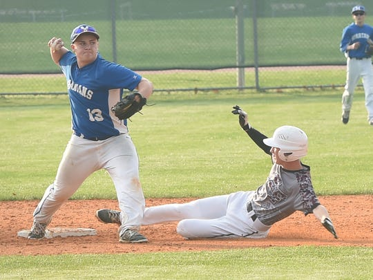 McConnellsburg's Justin Welsh (13) makes the play for the out at second base against Zack Clack (8) of Southern Fulton last year. The team's will meet again for the first time in 2016 on Friday, April 8 at Southern Fulton.