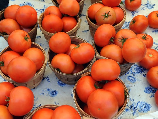 Tomatoes are displayed at the Windsor Farmers' Market in this file photo.