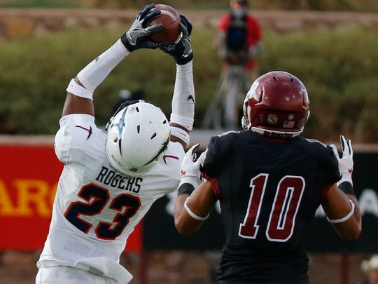 UTEP cornerback Justin Rogers goes up and pull st he