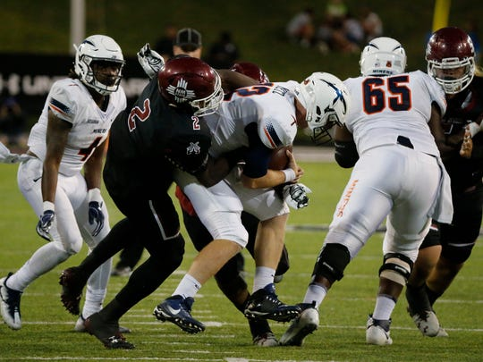 UTEP quarterback Ryan Metz had no chance of getting this ball off as he was swarmed in the backfield by the Aggies defense. The Miners trailed at half 21-7.