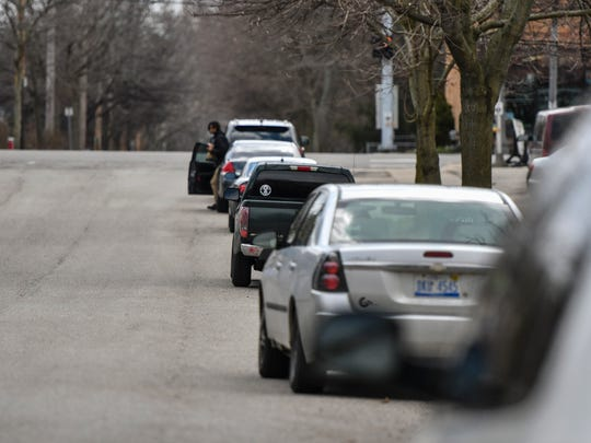 Vehicles are parked in Lansing along S. Hayford Avenue near E. Michigan Avenue Tuesday, April 10, 2018. Lansing City Council is considering revising the city's parking rules.
