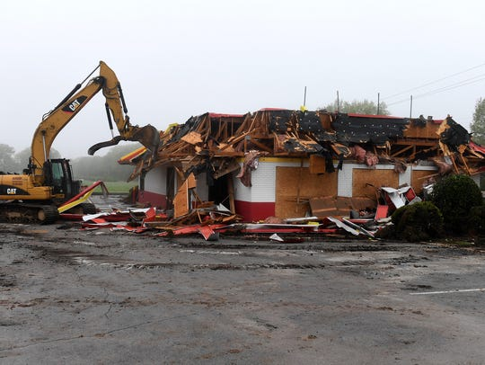 An excavator demolishes the 35-year-old McDonald's