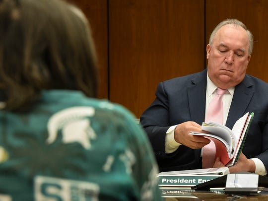 MSU interim President John Engler pictured Friday, June 22, 2018, during the first MSU Board of Trustees meeting since the $500 million settlement stemming from the Larry Nassar scandal.  [AP Photo/Matthew Dae Smith/Lansing State Journal]