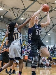 Lakeview's Sunshine Johnson (50) goes for the hoop