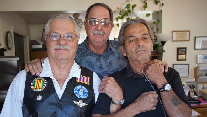 Vietnam veterans Pete Carter (from left), Bruce Raftery and Dennie Victornio discuss their bond as servicemen. Veterans in Southern Utah have volunteered to be armed guards at St. George-area schools.