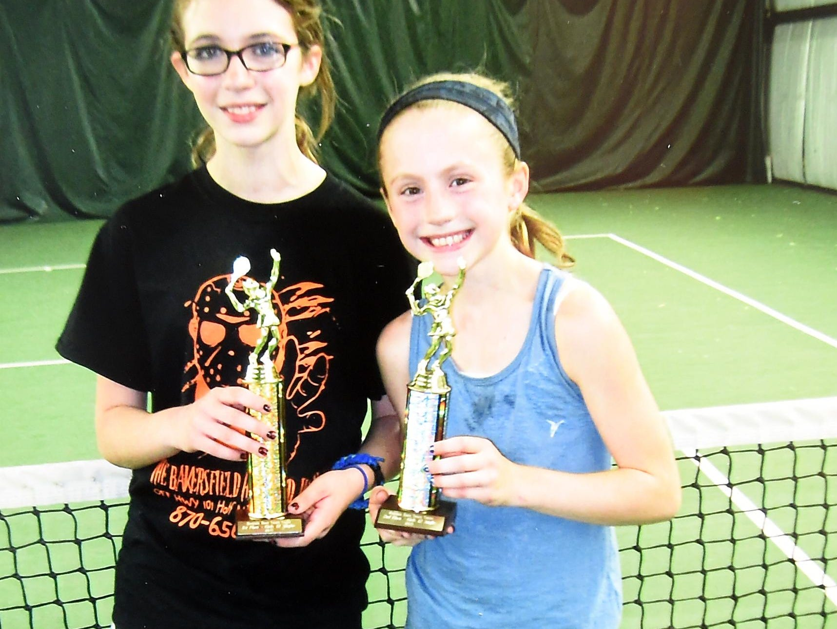 Micaela McLean, left, for the second straight year won the girls' 12-and-under division of the singles tournament held over the weekend at the Mountain Home Tennis Center. McLean defeated runner-up Riley Schmidt, right, 6-3, 6-1, in the finals. McLean defeated Sarah Godrey 6-1, 6-3 in one semifinal, and Schmidt defeated Macie Heide 2-6, 6-3, 11-9 in the other semifinal.