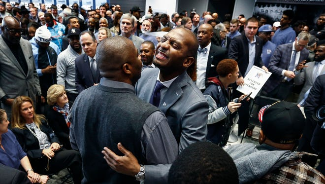 "Anfernee ""Penny"" Hardaway smiles while getting hugs from Tigers fans after introduced as the University of Memphis' new head basketball coach at the Laurie-Walton Family Basketball Center Tuesday morning. Hardaway, who a standout player at the U of M from 91-93, will take over for recently fired head coach Tubby Smith."