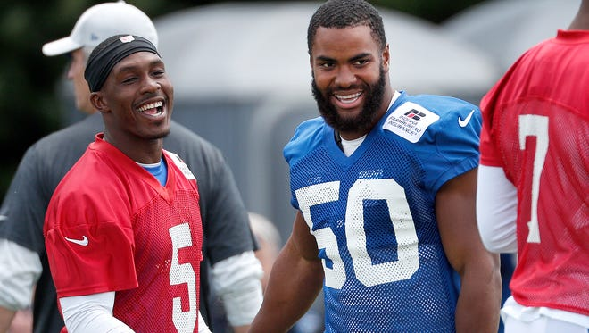 Indianapolis Colts linebacker Anthony Walker (50) shares a laugh with quarterback Phillip Walker (5) during their training camp at Grand Park in Westfield on Friday, July 27, 2018.