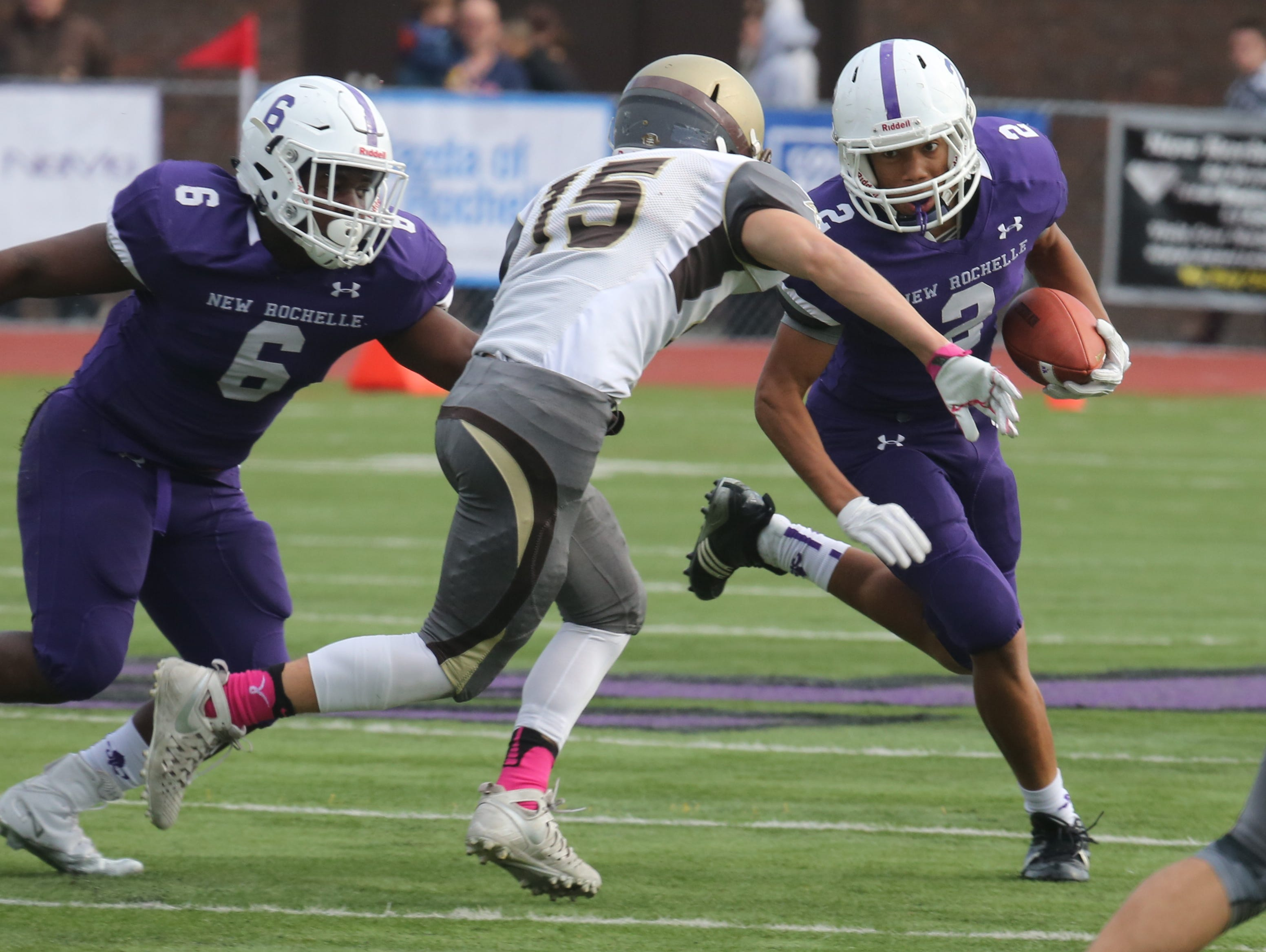 New Rochelle's Romeo Holden is eye to eye with Clarkstown South's Bodhi Gallo during their Class AA semifinal in New Rochelle Oct. 29, 2016.