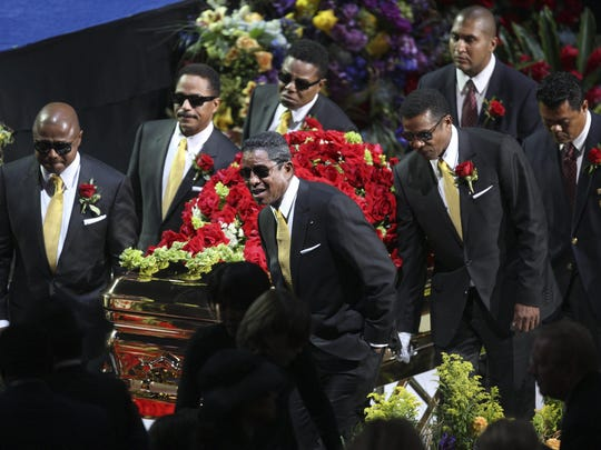 In this July 7, 2009 file photo, the Jackson brothers, from back left, Randy Jackson, Marlon Jackson and Tito Jackson, and from front left, Jermaine Jackson and Jackie Jackson carry the casket at the memorial service for the late pop star Michael Jackson in Los Angeles. Michael Jackson died on June 25, 2009.