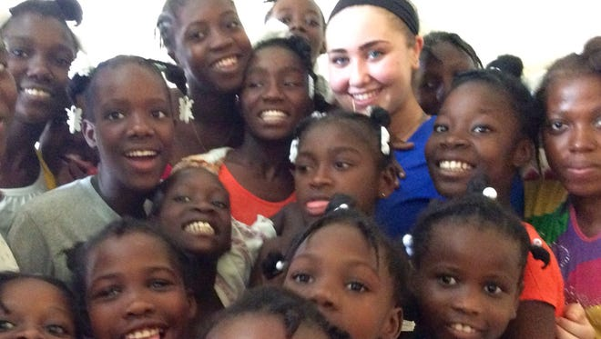 Mackenzie Rohde of Franklin Lakes, a rising senior at the Oak Knoll School of the Holy Child in Summit, was a magnet for the young children she visited during a four-day trip to various orphanages in Haiti.