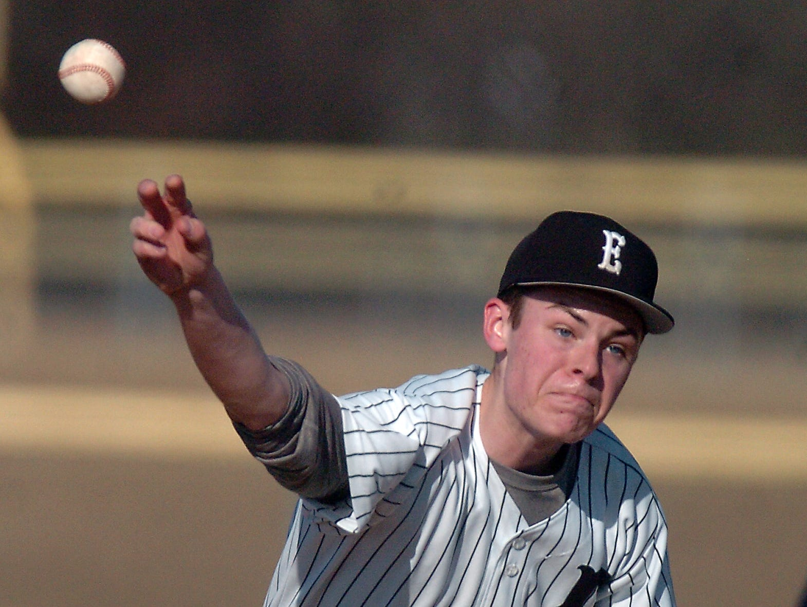 South Lyon East's Harrison Tanner throws against Plymouth.