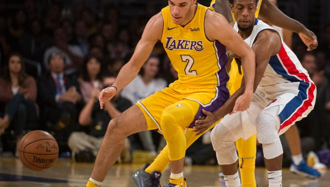 Lakers guard Lonzo Ball, left, loses handle of the ball as Pistons guard Ish Smith defends during the first half on Tuesday, Oct. 31, 2017, in Los Angeles.