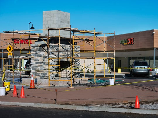 An outdoor fireplace in construction at West Manchester Town Center.