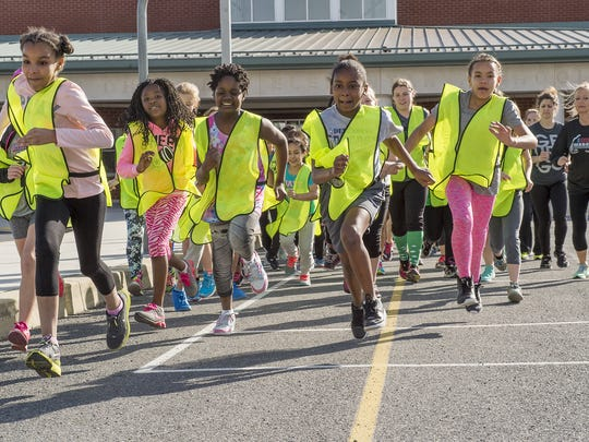 Fourth- and fifth-grade girls who participate in the Go Girls Go program at Benjamin Chambers Elementary School run to build endurance for their entry in the Cumberland Valley Breast Care Alliance 5k run/ walk.