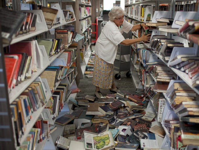 Napa County Library worker Chris Geyer sorts and reshelves books Aug. 25, the day after a magnitude-6.0 earthquake hit the San Francisco Bay area.