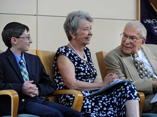 Philip Roseman, far right, talks with wife Jean and