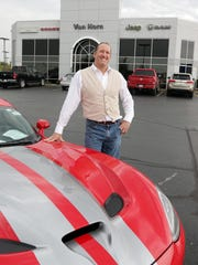 Van Horn owner Chuck VanHorn poses by a Dodge Viper Wednesday October 5, 2016 at his Plymouth dealership.