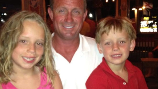 Brooke Downey, 10, with her brother Nathan, 8, with their dad Vince Downey. Brooke and Nathan were killed in a crash on I-10 Tuesday afternoon.
