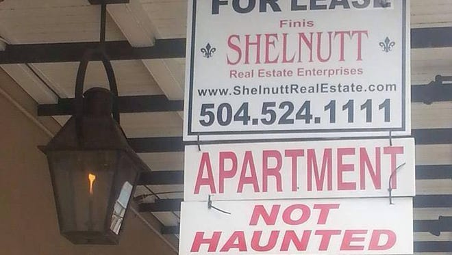 Sign outside of one of the properties listed by Shelnutt Real Estate assures potential renters it has no ghostly tenants.