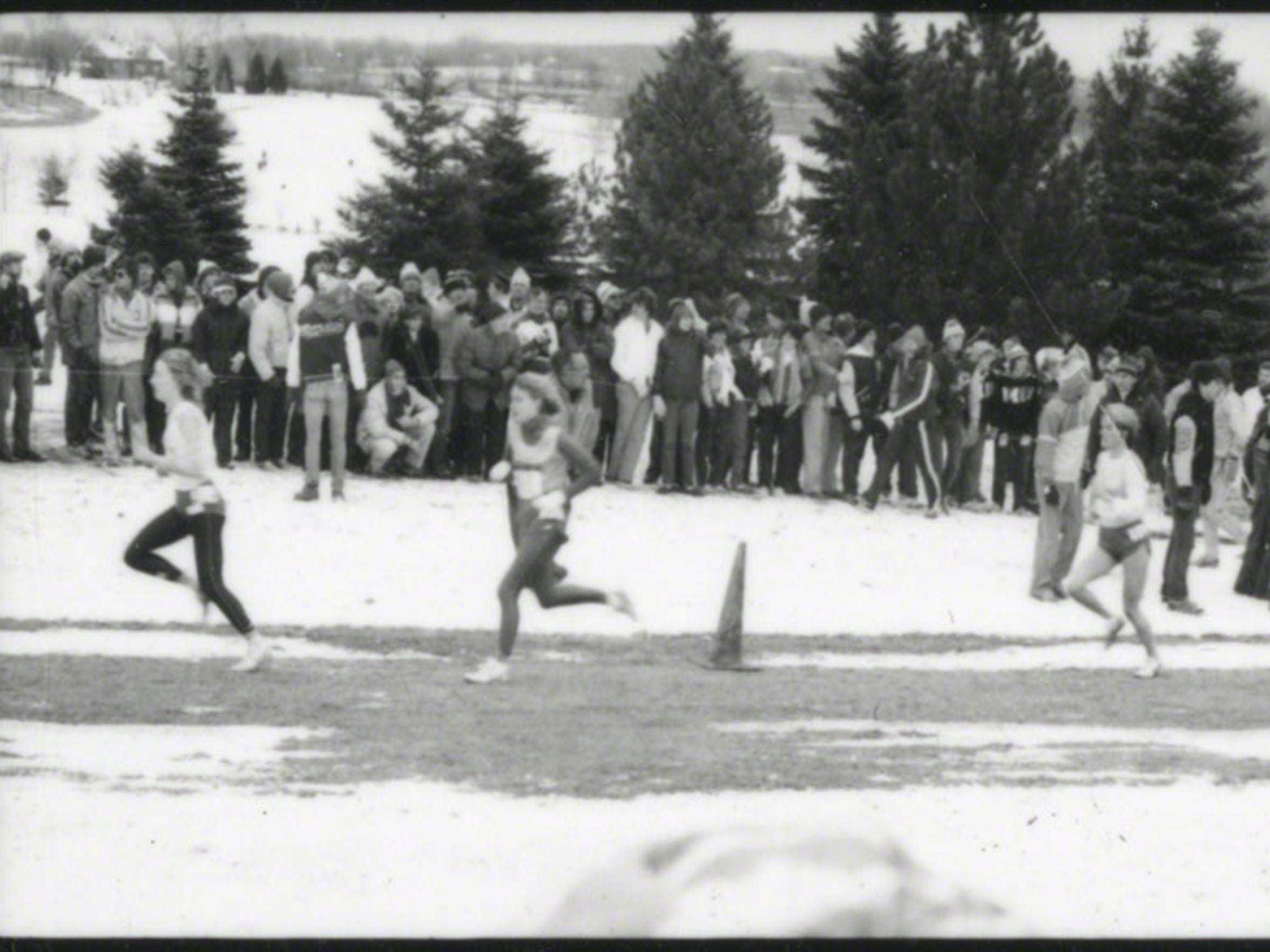 Sheryl Maahs (middle runner) and Julie Rose (third runner) run through the cold at the NCAA National Cross Country Championships on Nov. 25, 1985, in Wisconsin.