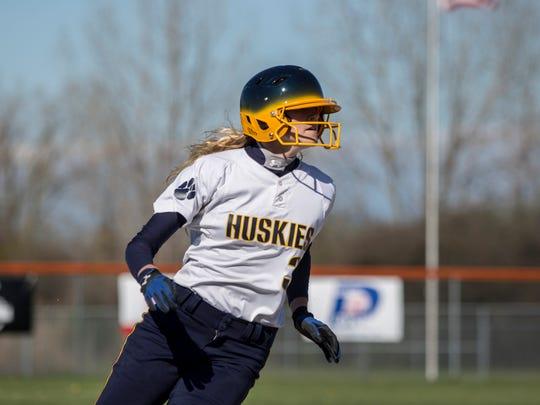 Port Huron Northern's Sami Klink rounds third base