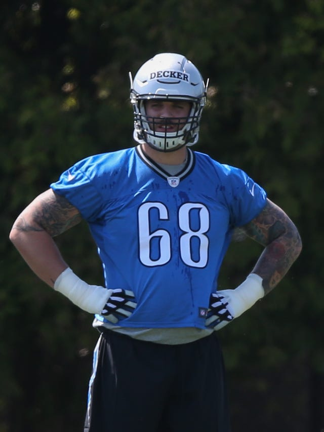 new arrival 8e7e8 7f158 Lions' Taylor Decker lines up at left tackle during minicamp