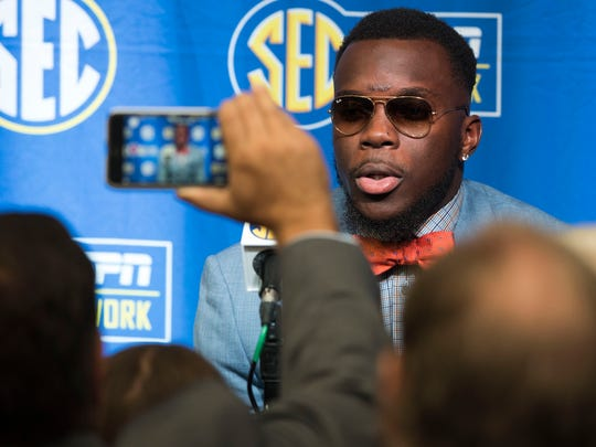Auburn linebacker Deshaun Davis talks to the press