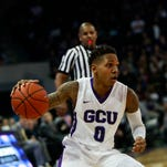 Grand Canyon University guard DeWayne Russell drives to the basket as Grand Canyon University faces off against Seattle University on Saturday, Jan. 30, 2016, at Grand Canyon University Arena in Phoenix, Ariz.