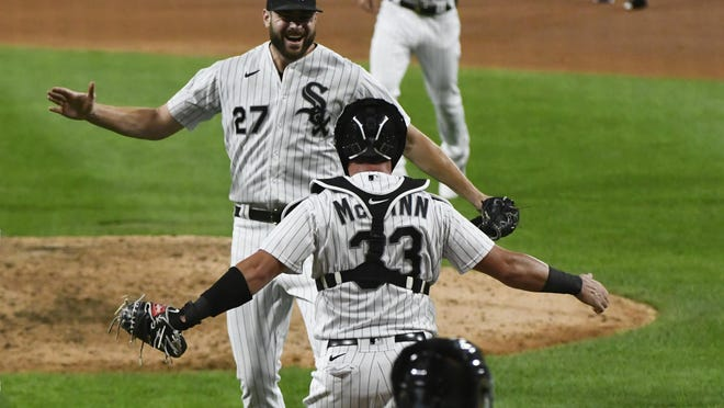 Chicago White Sox starting pitcher Lucas Giolito (27) reacts with catcher James McCann (33) after closing out a no hitter at the end of a baseball game against the Pittsburgh Pirates, Tuesday, Aug. 25, 2020, in Chicago. McCann is a former Erie SEaWolves catcher. MATT MARTON/ASSOCIATED PRESS]