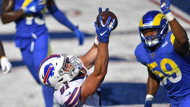 Buffalo Bills' Tyler Kroft (81) catches a pass for the game winning touchdown in front of Los Angeles Rams' Micah Kiser (59) during the second half  Sunday, Aug. 26, 2018, in Orchard Park, N.Y. The Bills won 35-32.