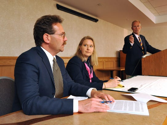 Attorneys Matthew Theil, left, Gilion Dumas, center, and Kelly Clark address the media during a press conference, Wednesday, Sept. 7, 2011 at the Holiday Inn in Great Falls, Mont., where they announce a civil lawsuit against the Montana Council of the Boy Scouts of America on behalf of 5 adult women who were sexually abused as children.