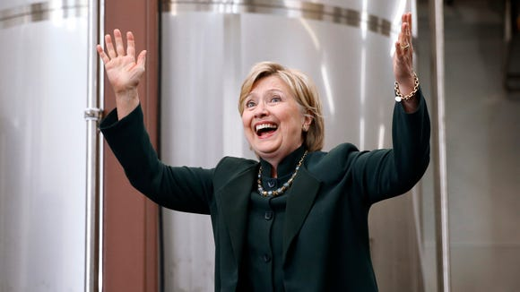 Hillary Clinton waves as she arrives at a campaign