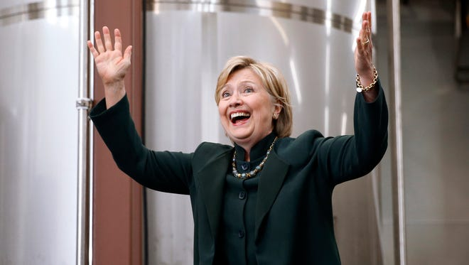 Hillary Clinton waves as she arrives at a campaign stop at Jackie O's Production Brewery and Tap Room in Athens, Ohio, on May 3, 2016.
