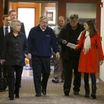 Gov. Branstad accompanied First Lady Chris Branstad as she voted  Tuesday, November 4, 2014, at Plymouth Congregational Church, Des Moines, IA. The Governor voted early through an absentee ballot. A couple reporters ask the Governor a few questions on his way into the polling place.
