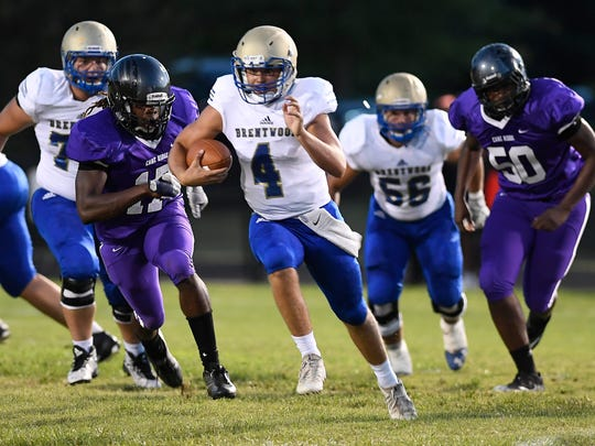 Brentwood quarterback Carson Shacklett (4) races up the field past the Cane Ridge defense during the second quarter at Cane Ridge High School Friday, Aug. 25, 2017 in Nashville, Tenn.