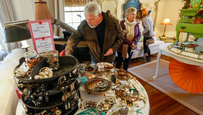 David Ray looks at watches inside the Humboldt Mansion during an estate sale on Wednesday, April 4, 2018.