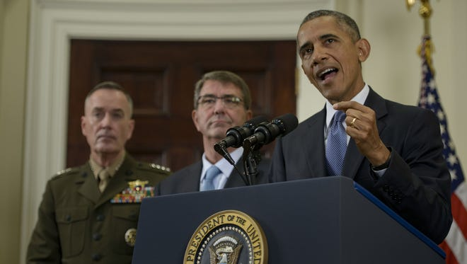 Chairman of the Joint Chiefs of Staff Marine Gen. Joseph Dunford and Secretary of Defense Ashton Carter listen while President Obama makes a statement in the Roosevelt Room of the White House on Oct.15, 2015.