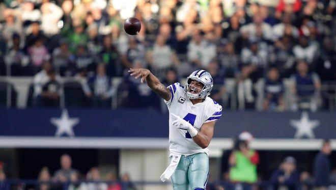 Dec 24, 2017; Arlington, TX, USA; Dallas Cowboys quarterback Dak Prescott (4) throws against the Seattle Seahawks at AT&T Stadium. Seattle won 21-12. Mandatory Credit: Erich Schlegel-USA TODAY Sports