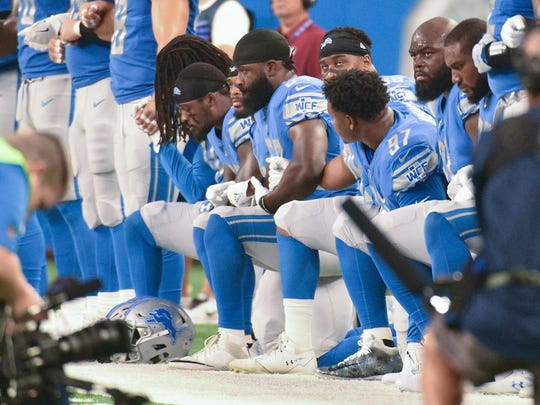 Sep 24, 2017; Detroit, MI, USA; Detroit Lions players kneel during the National Anthem before the game against the Atlanta Falcons at Ford Field. Mandatory Credit: Tim Fuller-USA TODAY Sports