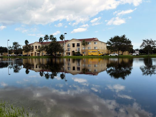 First-floor residents were forced to evacuate their homes Sept. 14, 2017, because of flooding caused by Hurricane Irma at Sabal Chase Apartments in Fort Pierce. Irma caused nearly $7 million in damage to at least 26 St. Lucie County roads.
