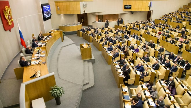 Russian lawmakers vote at the State Duma (lower parliament house) in Moscow, Jan. 27, 2017. The State Duma voted 380-3 to eliminate criminal liability for battery on family members that doesn't cause bodily harm, making it punishable by a fine or a 15-day day arrest.